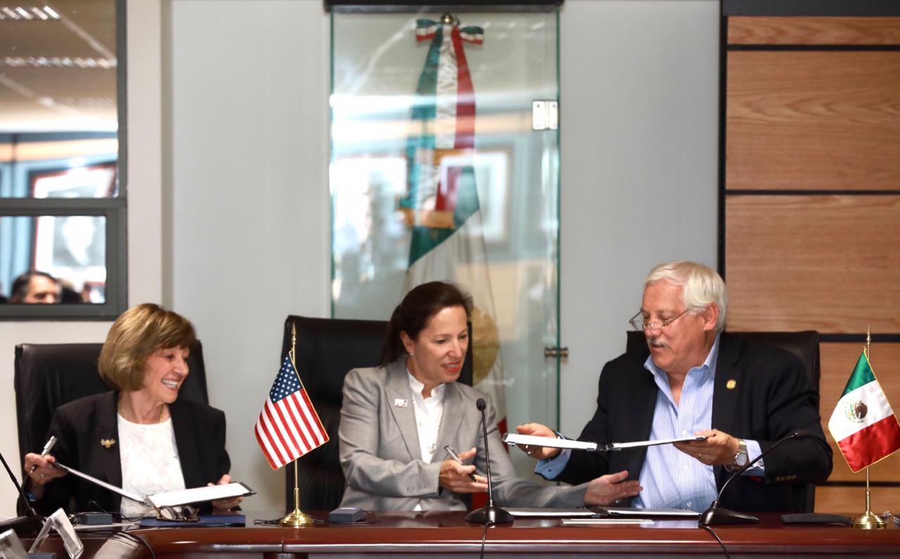 California Department of Food and Agriculture Secretary Karen Ross signs an MOU along with Lt. Governor Eleni Kounalakis and Mexico Agricultural Secretary Victor Villalobos Arambula.